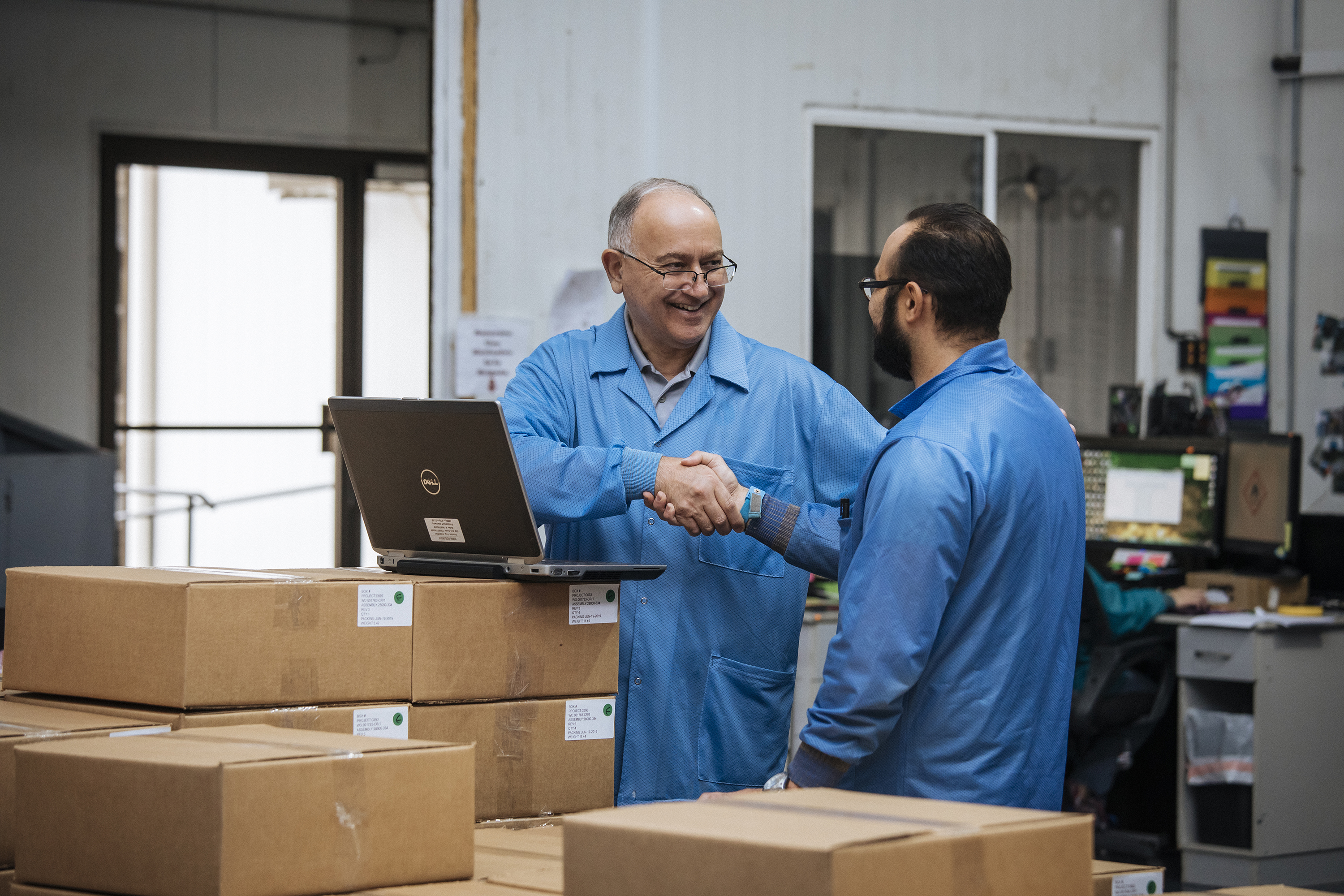 Supplier shaking hands and smiling